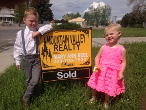 mountain valley realty home sold sign
