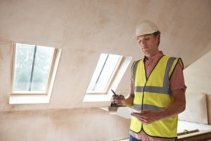 43055562 - building inspector looking at new property